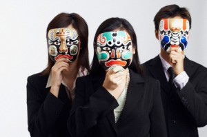 Close-up of two businesswomen and a businessman wearing masks